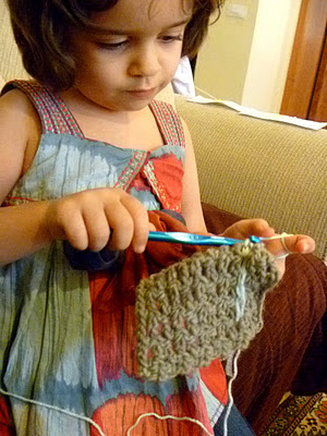This is not me, but she sure it cute! Click on the picture and you'll find out how her mom taught her to crochet!